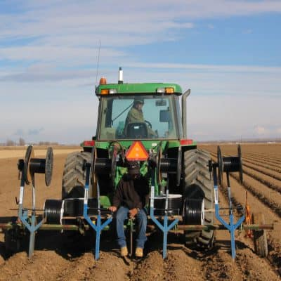 Snake Ranch Farm installation of drip irrigation tape