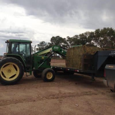 Snake Ranch Farm loading 4X4 bales