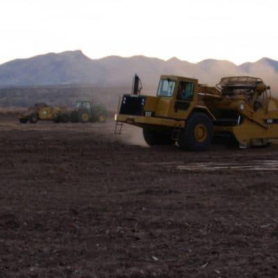 Snake Ranch Farm paddlewheel scraper moving yards of dirt