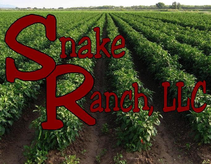 Snake Ranch LLC logo and text on top of picture of their farm