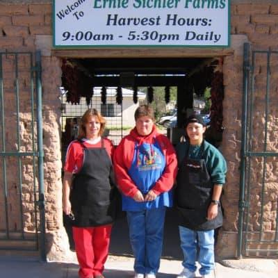 Sichler family members standing outside farm entrance